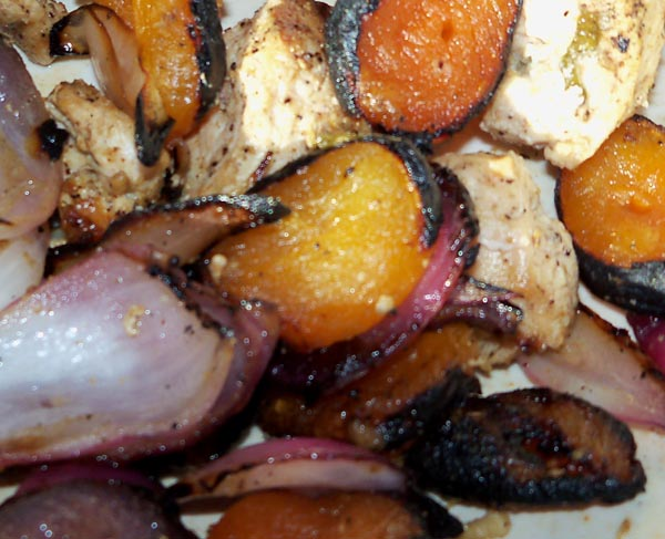 Chicken kebab in a bowl with apricots and onions