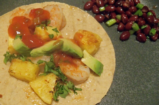 Shrimp and pineapple taco with bean salad